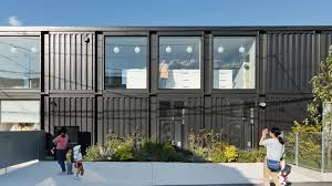shipping containers make up this sleek japanese kindergarten curbed