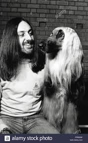 afghan hound national dog show man with his afghan hound at dog show in the 1980s stock photo