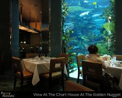 dining room table fish tank looking at aquarium from dining table at chart house in las vegas