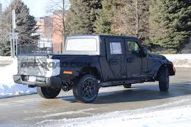 jeep truck spy photos jeep scrambler pickup spotted again in spy shots off road com blog