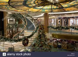christmas decorations adorn the atrium of the oceana a cruise