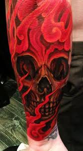 collection of 25 evil skull and flames tattoos on arm