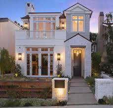 dark grey house with white trim simple painting in dark wood