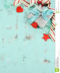modern red and white christmas decorations on aqua blue wood