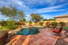 adobe style home for sale near numerous local golf courses pool and rock fall
