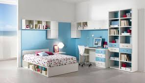 cheerful teenage bedroom scheme with light blue and white accent deluxe bedroom design interior showcasing modern wall units with brilliant stone texture backsplash with comfy lounge chair for best colors