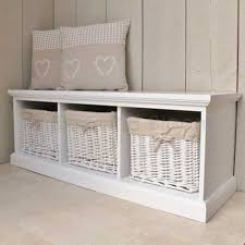 entryway bench with storage baskets railing stairs and kitchen
