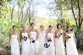 cream bridesmaid dresses blue and purple bouquets accent green