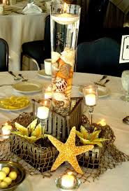 centerpieces for beach themed baby shower with real fish and
