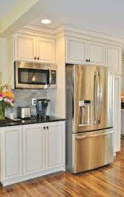 kitchen appliance ideas microwave shelf quartz with white cabinets stainless