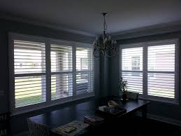 Cozy Dining Room Decorating Cozy Dining Room Design With Sunburst Shutters On Gray