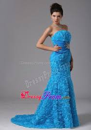 blue mermaid prom dresses with beading and rolling flowers