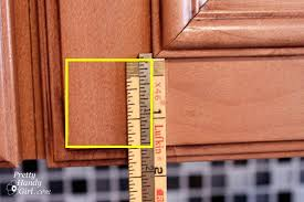 installing cabinet knobs pretty handy on kitchen cabinets the
