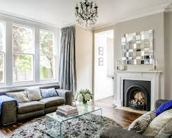gray fur round rug and classic fireplace for small living room