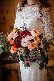 theme wedding bouquets marsala pantone color maine rustic wedding venue