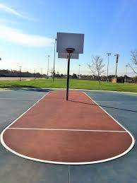 free throw line on one of the half court basketball courts at
