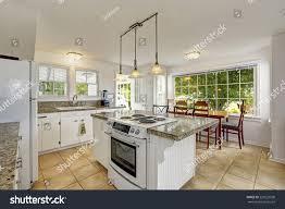 granite top kitchen islands white kitchen room granite tops kitchen stock photo 220229590
