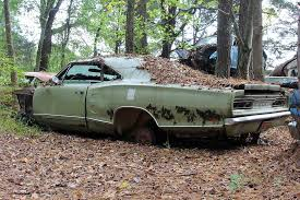 car junkyard near me old car city u s a is full of abandoned muscle cars and classics