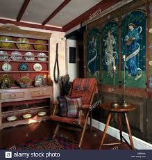 medieval style mural on paneled wall in small country dining room medieval style mural on paneled wall in small country dining room with antique dresser and