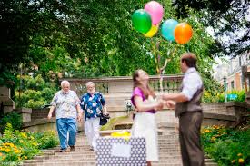 a surprise vow renewal with a giant box of balloons
