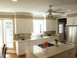 how to add value to your home by installing crown moldings decor low ceiling kitchen with crown molding white cabinets and gloss countertop