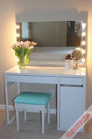 swanky white polished ikea vanity desk with wall square mirror