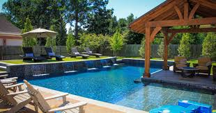 Wooden Chairs Facing Pool In Backyard Designs With Calm Deck Color - Backyard stage design
