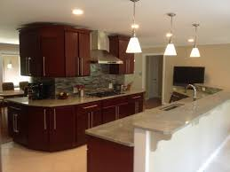Shaker Cherry Kitchen Cabinets Brown Countertops Wood Floors And - Light cherry kitchen cabinets