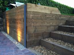 finished retaining sleeper wall steps block paving driveway and