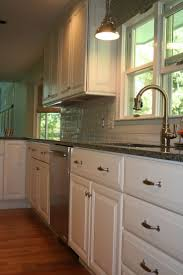 Candlelight Kitchen Cabinets Green Trees Outside Kitchen With White Raised Panel Door