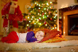 adorable little sleeping under the christmas tree by a