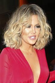 cutting hair so it curves under khloe kardashian wavy medium brown barrel curls blunt cut