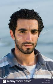 middle eastern hair cuts for men portrait of a young middle eastern male by the sea beirut lebanon