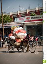 indian cart indian man carrying vegetable sacks on hand cart editorial