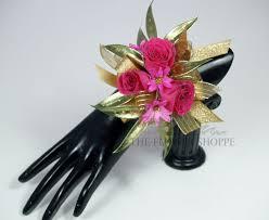 wrist corsage hot pink gold wrist corsage in pratt ks the flower shoppe
