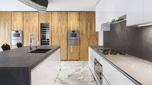 wood kitchen with an island made of stone