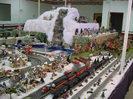 collection of christmas village with train christmas tree
