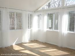 beautiful hang curtains excellent how to hang curtains pottery