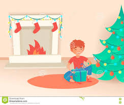 boy with gift christmas or new year near the decorated tree and
