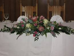 wedding flowers oxford top table arrangement of protea roses lisianthus for a wedding