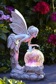 garden statue with globe solar powered lawn ornaments outdoor