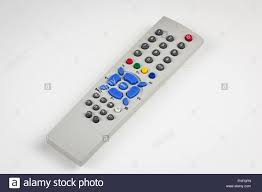 dusty old simple tv remote over white background stock photo