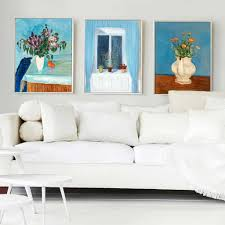 nice living room decorated with canvas painting arts in the grey