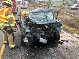 sheriff woman attempting to pass another vehicle dies in head o