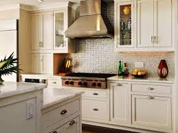 stainless steel backsplash ushaped kitchen idea in seattle with a