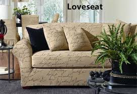Stretch Wing Chair Slipcover In Stretch Pen Pal With A French Script Motif
