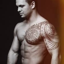 polynesian on his shoulder and chest in