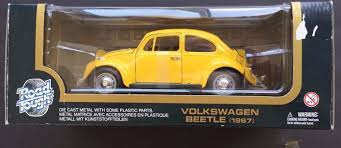 volkswagen yellow yatming road signature collection 1967 red volkswagen beetle 1 18