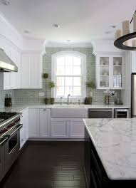 gray kitchen cabinets with white marble countertops 25 breathtaking carrara marble kitchens for your inspiration