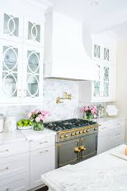 white kitchen cabinets with marble counters s guide to marble countertops randi garrett design